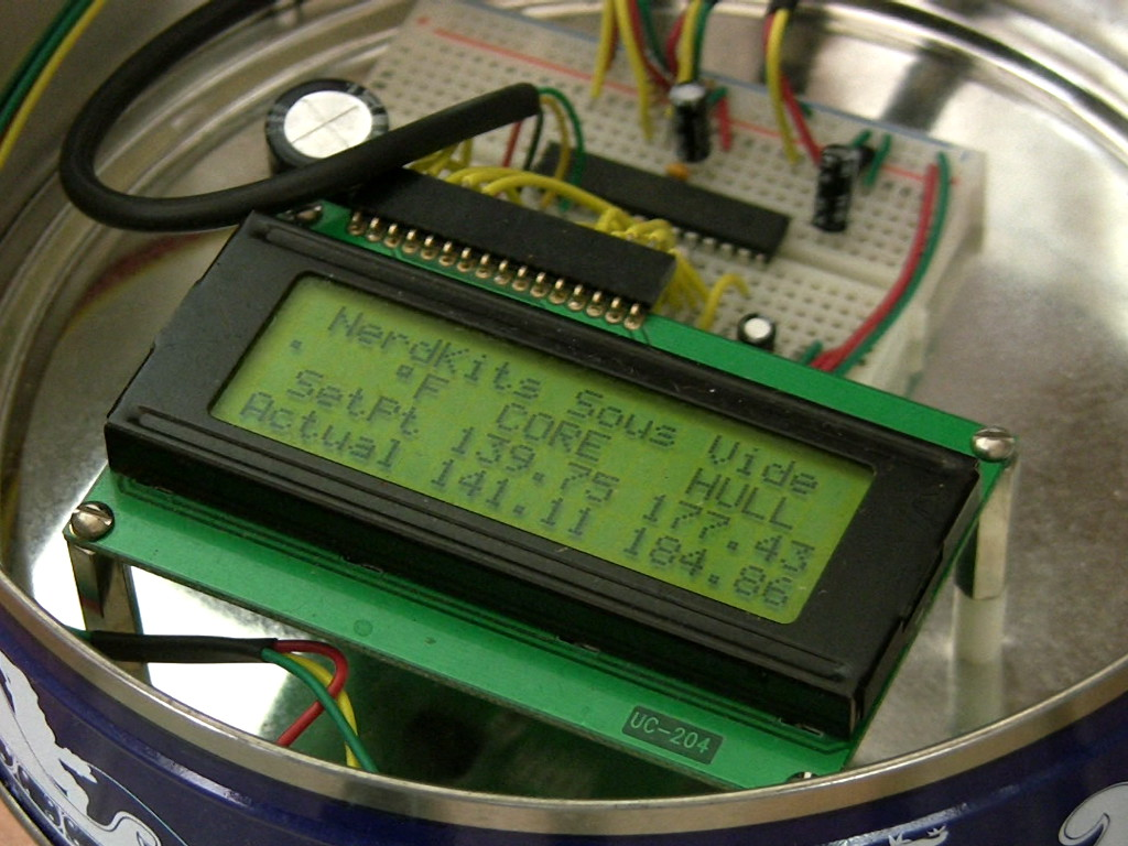 Nerdkits Diy Sous Vide Cooker With Feedback Control Colorsensorcircuit Light Sensor Circuitclick For Next Circuit The Microcontroller Breadboard And Lcd Are Mounted Inside A Holiday Cookie Tin
